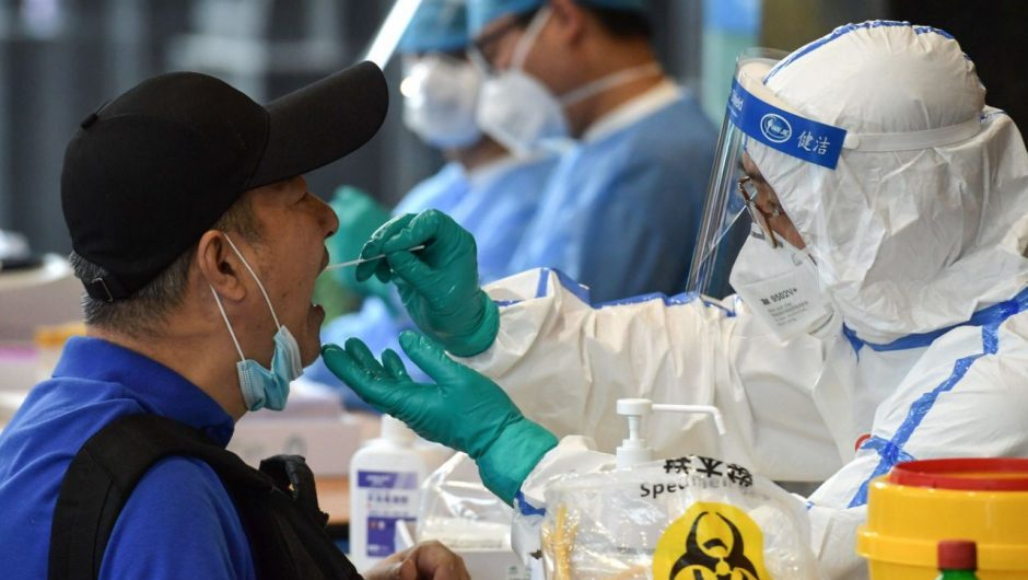China shuts schools and cancels flights as Beijing reports an 'extremely grave' surge in new coronavirus cases